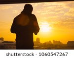 silhouette of a woman with... | Shutterstock . vector #1060547267