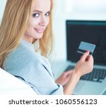 woman shopping online with... | Shutterstock . vector #1060556123