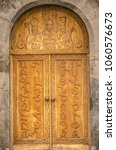 Small photo of Oshakan,Armenia,19 Februar,2018:Doors with Armenian alphabet on the entrance to the Church of St. Mesrop Mashtots in Oshakan village