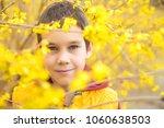 boy in the bush blooming... | Shutterstock . vector #1060638503