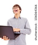Young man reading something on laptop and loudly laughing at it. Isolated on white background, mask included - stock photo