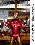 Small photo of Chachoengsao, Thailand - March 24, 2018: Iron Man model made from steel. Iron man life size figure in front of Movie theater at Wat Saman Ratanaram.
