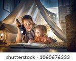 family bedtime. mom and child... | Shutterstock . vector #1060676333
