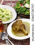 Small photo of iranian persian cuisine, braised lamb shank, baghali polo,sabzi khordan
