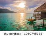 evening with sunset in moorea.... | Shutterstock . vector #1060745393