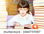 doing homework. young girl... | Shutterstock . vector #1060755587