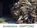 wooden background. firewood for ... | Shutterstock . vector #1060772363