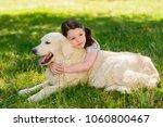 Thoughtful Child Hugs A Dog ...