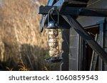 bird feeder cage on a wooden...   Shutterstock . vector #1060859543