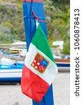 Small photo of Taormina, Sicily, Italy. 19/04/2015: The Italian Naval Ensign on a fishing boat in Taormina