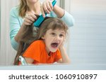 mom and daughter are having fun ... | Shutterstock . vector #1060910897