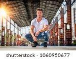attractive man in urban setting ...   Shutterstock . vector #1060950677