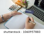 business accountant writing at... | Shutterstock . vector #1060957883