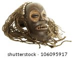Old antique african tribal mask isolated on white background - stock photo
