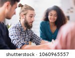 working meeting for a young... | Shutterstock . vector #1060965557