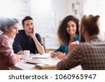 meeting at the startup office.... | Shutterstock . vector #1060965947