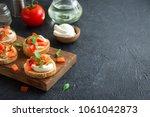 italian bruschetta with chopped ... | Shutterstock . vector #1061042873