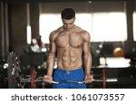 sexy strong bodybuilder... | Shutterstock . vector #1061073557