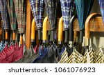 many umbrellas with wooden... | Shutterstock . vector #1061076923