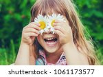 girl with chamomile. selective...   Shutterstock . vector #1061173577