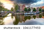 traditional dutch old houses on ... | Shutterstock . vector #1061177453