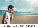 handsome young male in glasses... | Shutterstock . vector #1061189033