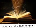 image of open antique book over ... | Shutterstock . vector #1061212223
