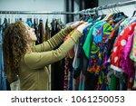 woman browsing through vintage...   Shutterstock . vector #1061250053
