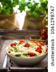 italian cuisine. pasta with...   Shutterstock . vector #1061298767