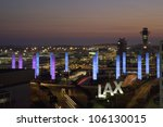 AUGUST 2007 - Aerial view of LAX Los Angeles International Airport at sunset with decorative light tubes, Los Angeles, California - stock photo