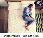 lonely man sleeping alone on... | Shutterstock . vector #1061356403