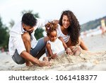 young mixed race family sitting ... | Shutterstock . vector #1061418377