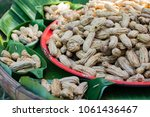 boiled peanuts. snack for good... | Shutterstock . vector #1061436467