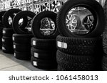 car tires and alloy wheels in... | Shutterstock . vector #1061458013