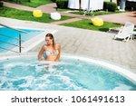 beautiful woman in outdoor... | Shutterstock . vector #1061491613