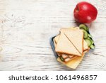 lunch box with tasty sandwich... | Shutterstock . vector #1061496857