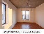 interior of an empty room with... | Shutterstock . vector #1061558183