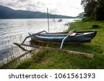 old wooden fishing boat on the... | Shutterstock . vector #1061561393