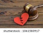 figure of a broken red heart ... | Shutterstock . vector #1061583917