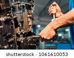 professional mechanic repairing ... | Shutterstock . vector #1061610053