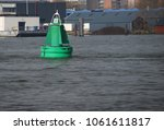 Small photo of Buoy for waterway on the nieuwe maas in Rotterdam, the netherlands.