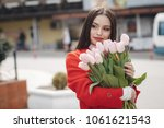 woman with tulips. beautiful... | Shutterstock . vector #1061621543