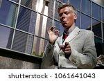 activist dresses as donald... | Shutterstock . vector #1061641043