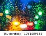 blurred car light trough wet... | Shutterstock . vector #1061659853
