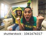 brazilian fan celebrating... | Shutterstock . vector #1061676317