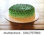 birthday cake. green decoration ...   Shutterstock . vector #1061707883