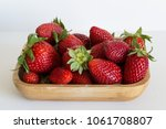 strawberries in the wooden box... | Shutterstock . vector #1061708807