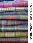 Small photo of Stack of plaid fabric background