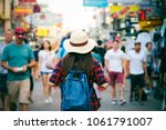 young asian woman with hat and... | Shutterstock . vector #1061791007
