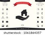 hand holding home   Shutterstock .eps vector #1061864357